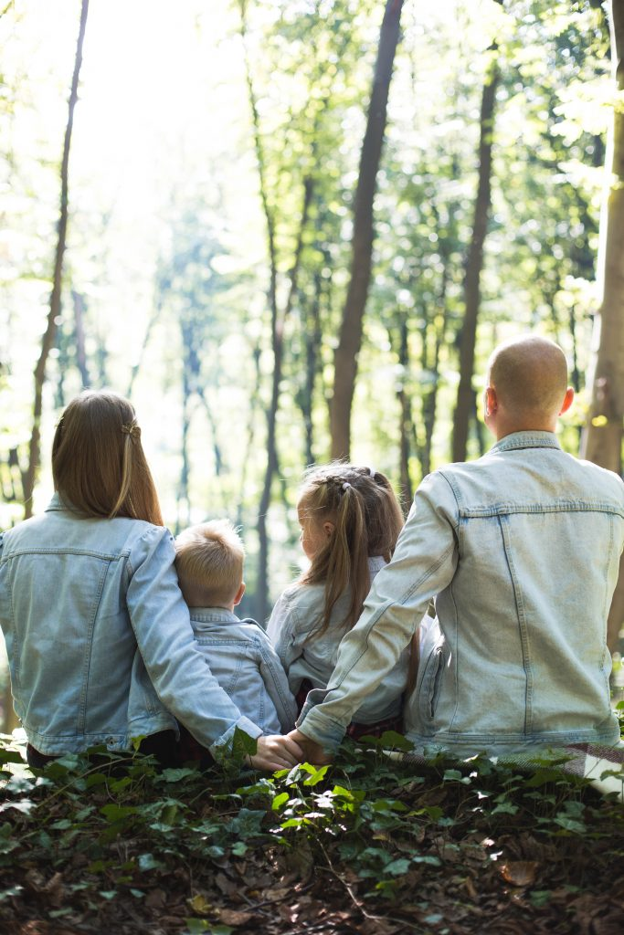 Family sitting in the forest